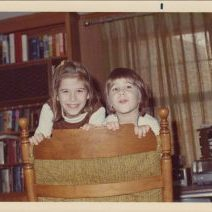 photo of Pam and Bridget looking over family room chair